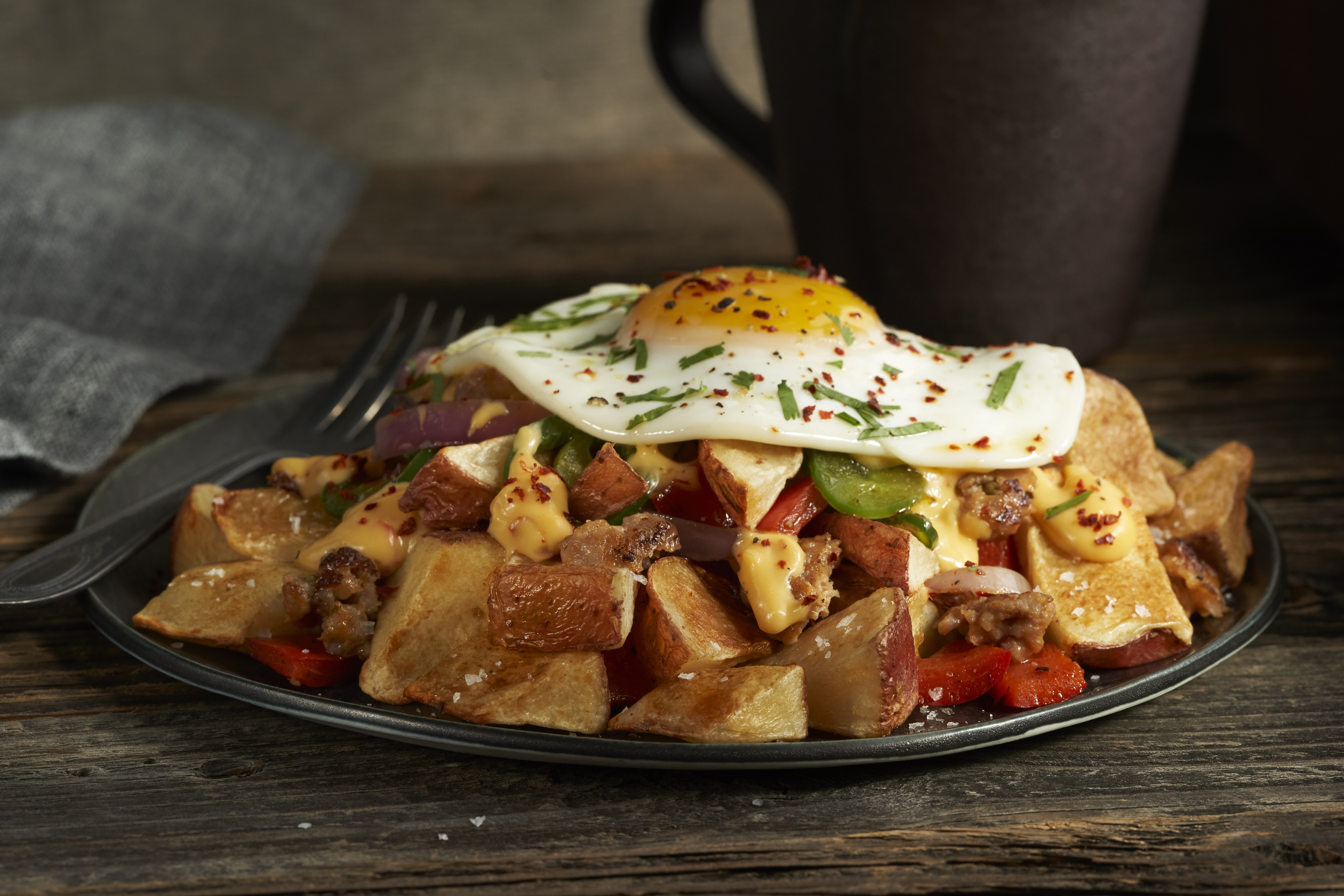 LW586 OVEN ROASTED RED SKIN TRI-CUT DICE PLATED WITH EGG, SAUSAGE AND GRILLED VEGETABLES