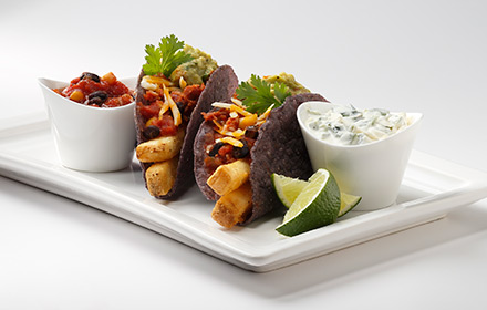 Seashore-Style, blue corn tortillas, black bean salsa, chorizo crumbled, shredded cheddar jack cheese, guacamole, roasted poblano cream, limes, cilantro, platter, ramekins, meal, entree, appetizers