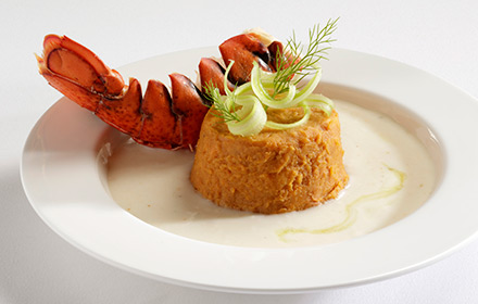 Lobster tail, lobster bisque sauce, celery strings, butter, lemon juice, cream of mushrooms, chicken broth, lobster base, tomato bisque, plated