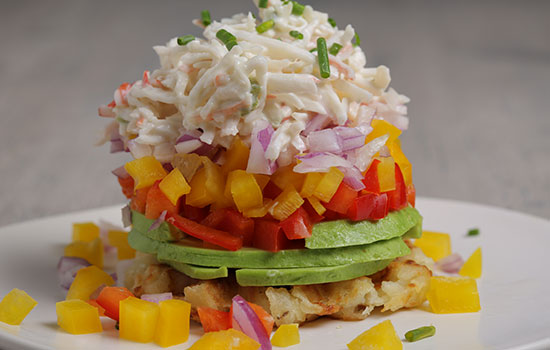 Waffled Hash Brown,  crab meat, olive oil, lime juice, tomato, red onion, red peppers, yellow peppers, serrano pepper, avocado, chives, plate, pile, Entree, appetizer