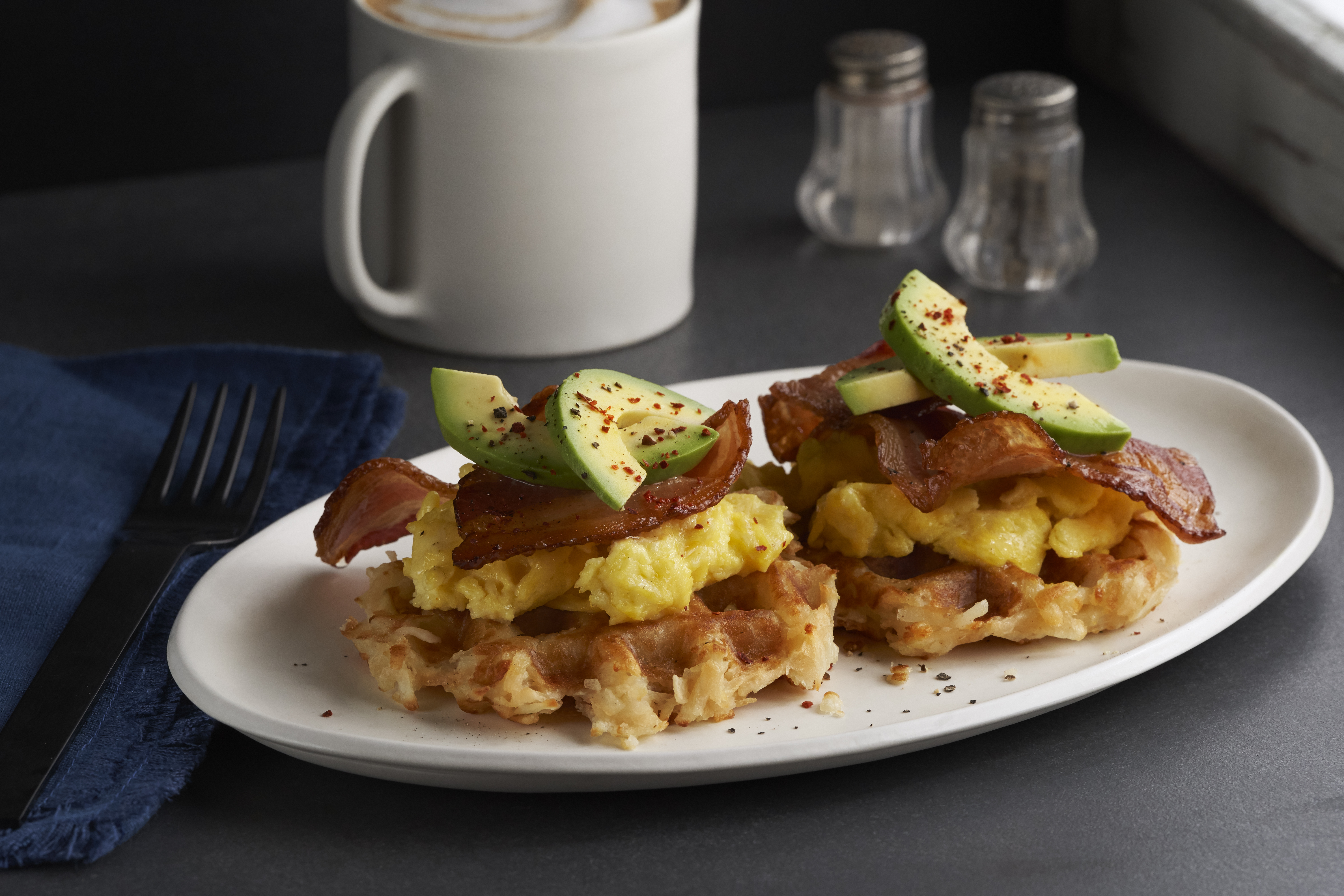 LW205 WAFFLED HASH BROWNS PLATED WITH SCRAMBLED EGGS, BACON AND AVOCADO